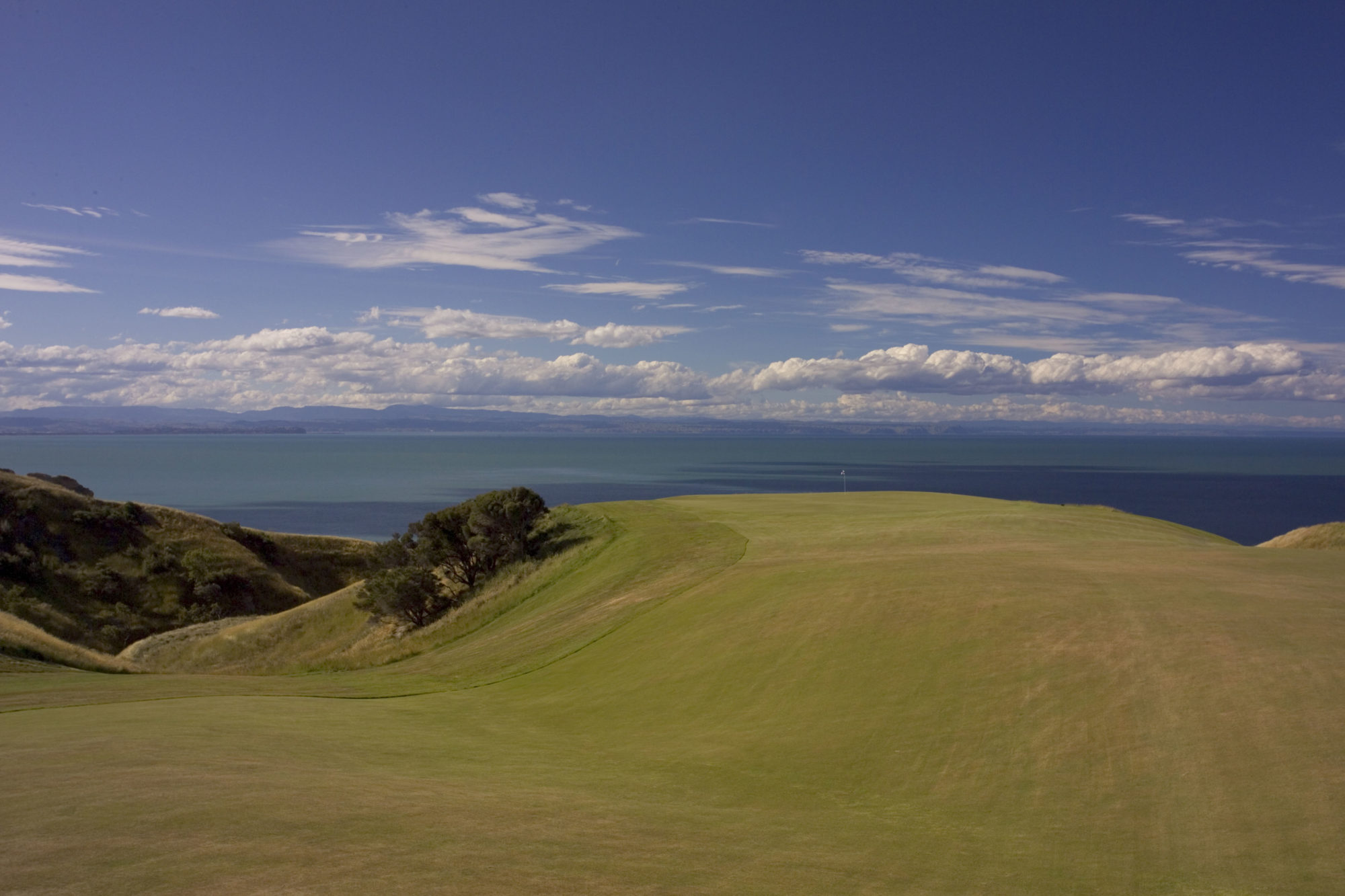 The par-4 12th [also featured as the opening post on the Play page, in its original pasture form] is the ultimate infinity green, 450 feet above Hawkes Bay.