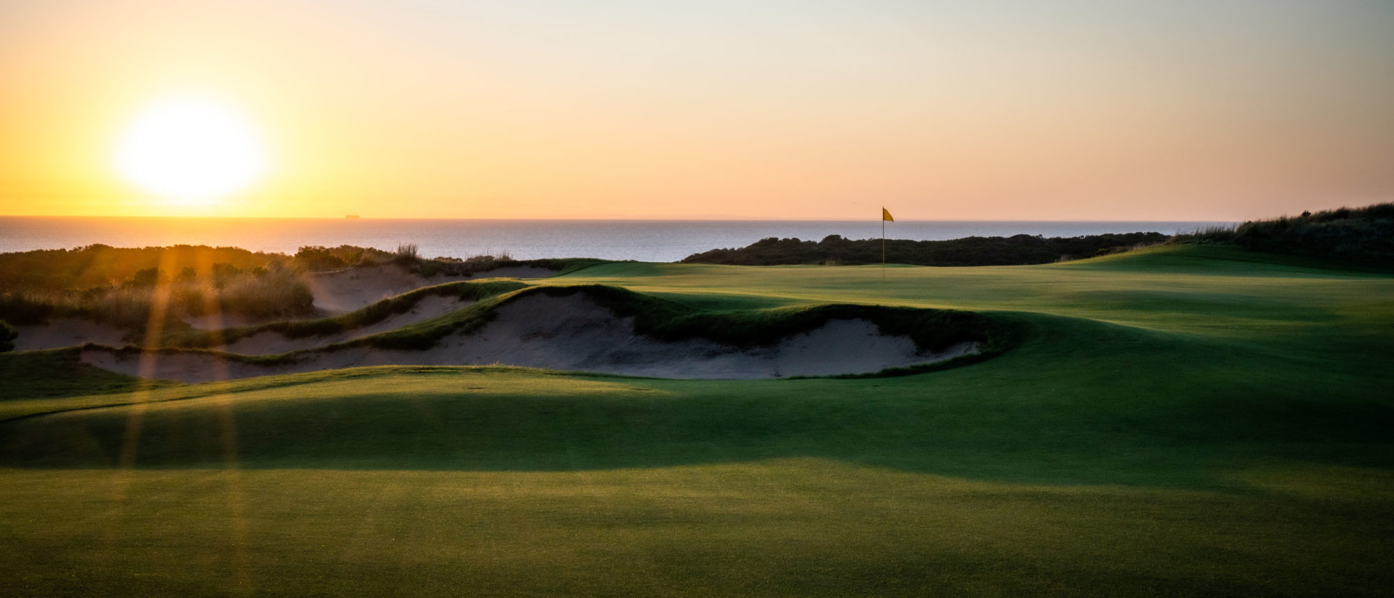 The elevations of the tee and green at the new par-3 16th are set so that players see the flag flying against the blue of the ocean in the background.