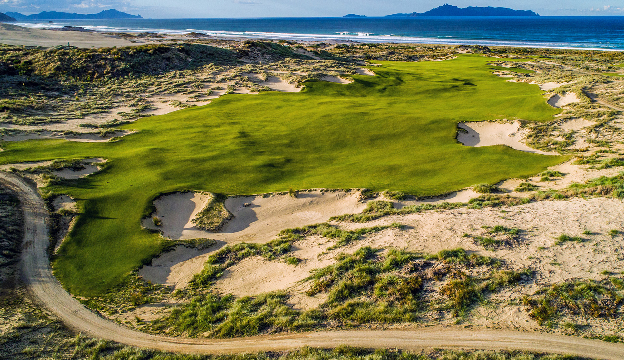 The par-4 14th plays directly toward the Hen and Chicks islands off the coast.