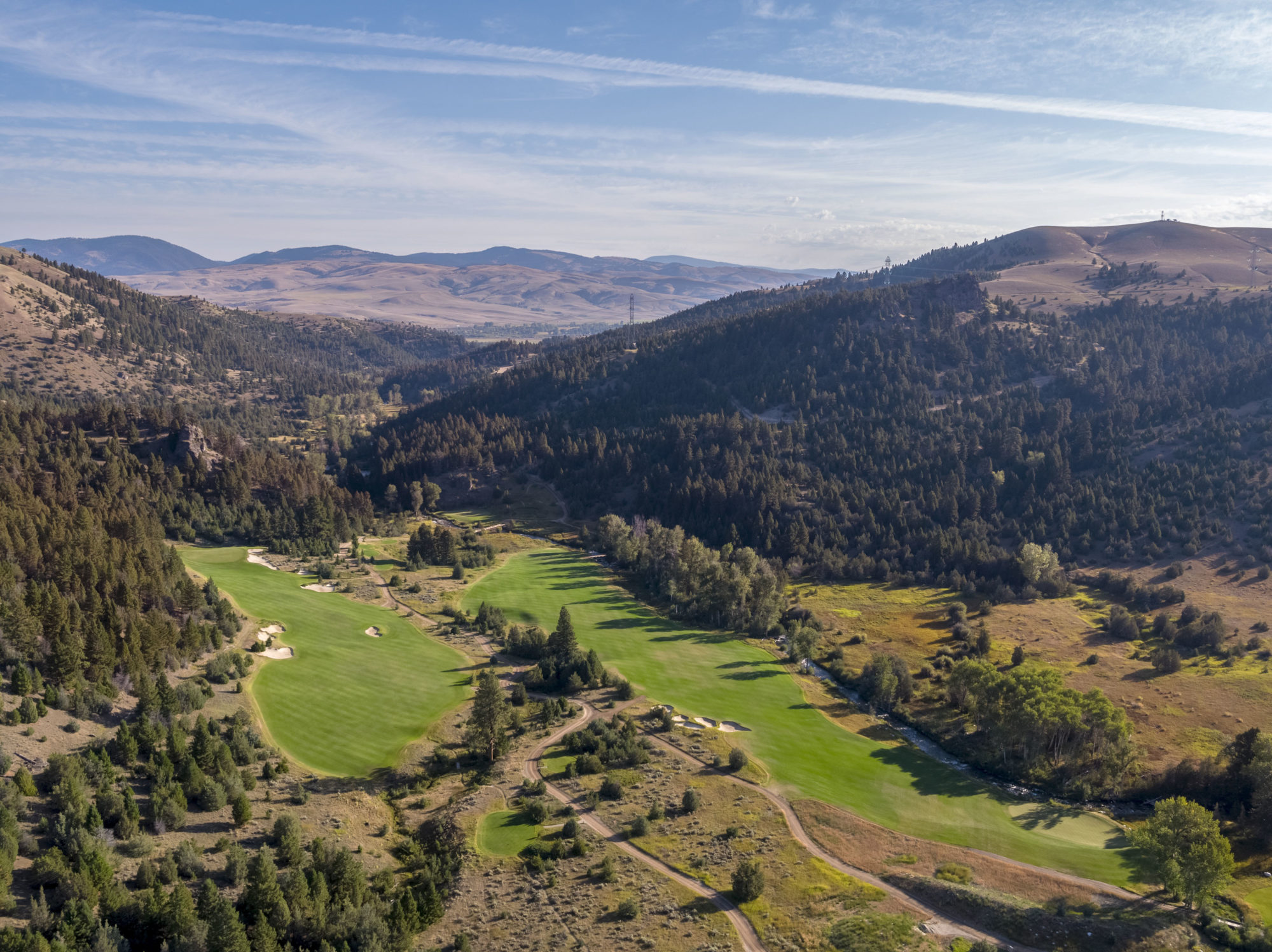 An overview of the last three holes in the valley; Rock Creek must be crossed at the par-3 17th, and then contended with on every shot coming back up the hill on the par-5 finisher.